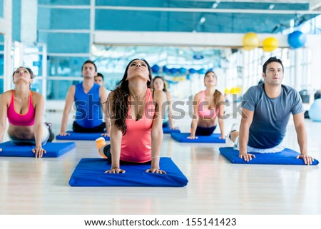 Group of people at the gym in a yoga class  - stock photo
