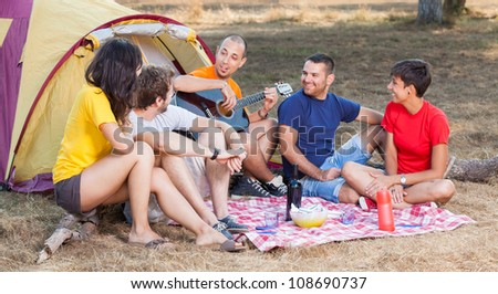 Group of People Camping and Singing - stock photo