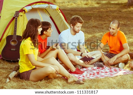 Group of People Camping and Telling Stories - stock photo