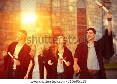 Group of people celebrating after Graduation against grey school building - stock photo