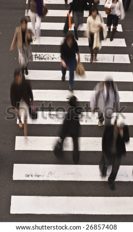 Group of people crossing the street-upper view - stock photo