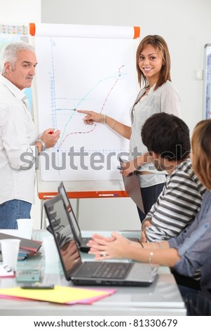 Group of people discussing a growth chart - stock photo