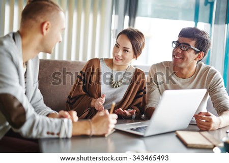 Group of people discussing plans in informal atmosphere - stock photo