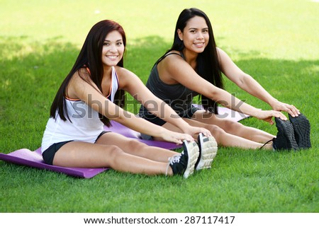 Group of people doing a boot camp workout outside - stock photo