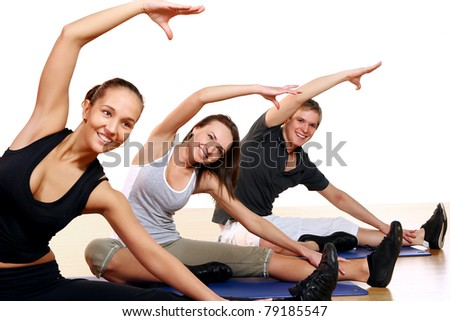 Group of People Doing Fitness Exercises in Gym - stock photo