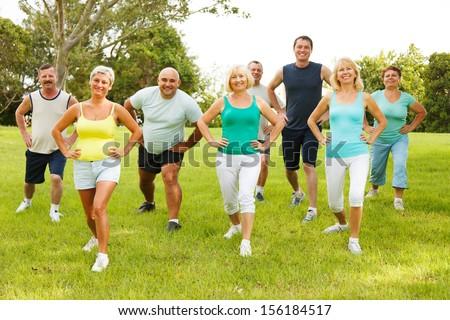 Group of People doing flexibility exercises - stock photo