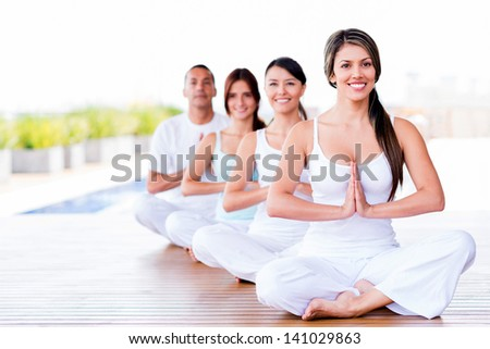Group of people doing yoga exercises and smiling - stock photo