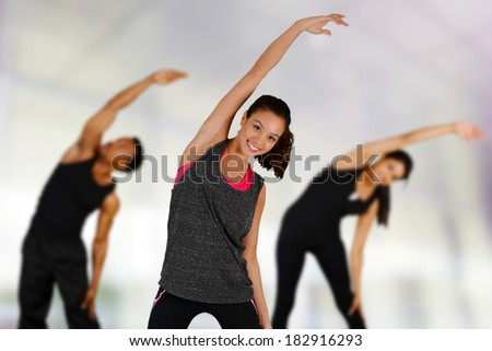 Group of people doing yoga while at the gym - stock photo