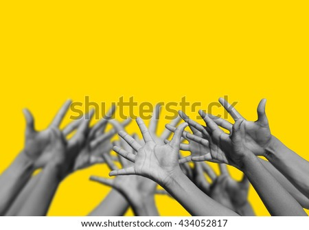 Group of people hands up for help   - stock photo