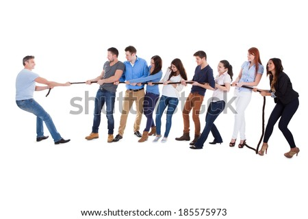 Group of people having a tug of war against one man as they pull on opposite sides of the rope conceptual of leadership  individuality  determination and challenge  on white - stock photo