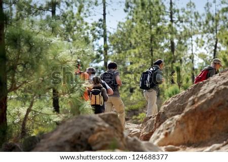 Group of people hiking - stock photo