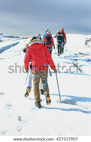 Group of people hiking on the glacier in South Iceland - stock photo