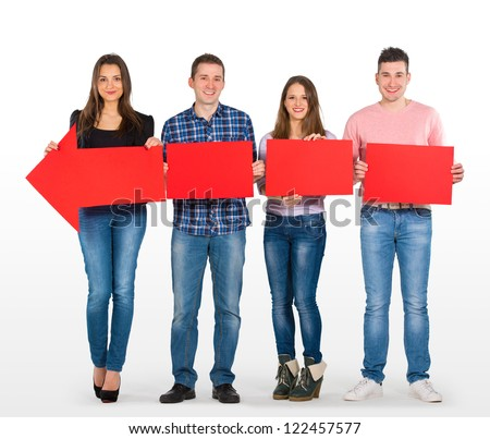 Group of people holding a big, red arrow - stock photo