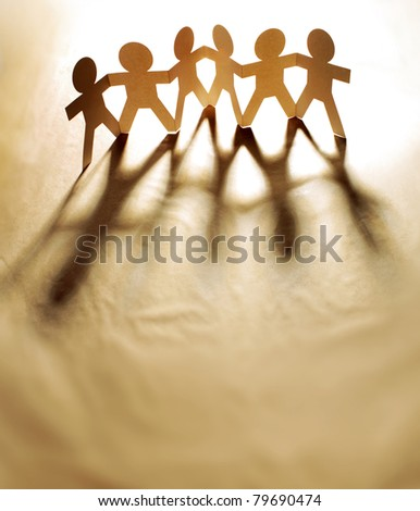 Group of people holding hands - stock photo