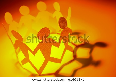 Group of people holding hands in a circle - stock photo