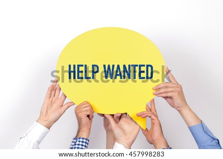 Group of people holding the HELP WANTED written speech bubble - stock photo