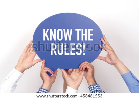 Group of people holding the KNOW THE RULES! written speech bubble - stock photo
