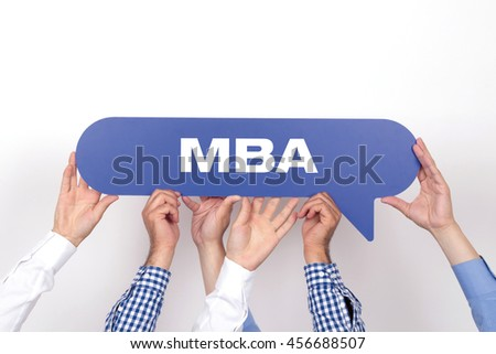 Group of people holding the MBA written speech bubble - stock photo