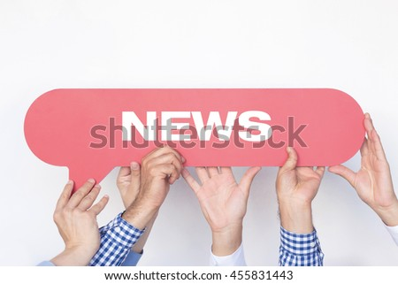 Group of people holding the News written speech bubble - stock photo