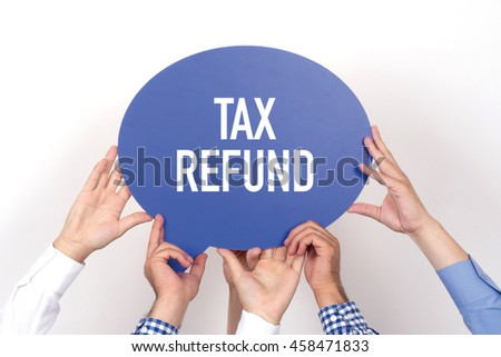 Group of people holding the TAX REFUND written speech bubble - stock photo