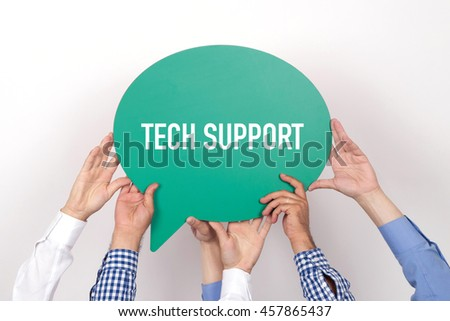 Group of people holding the TECH SUPPORT written speech bubble - stock photo