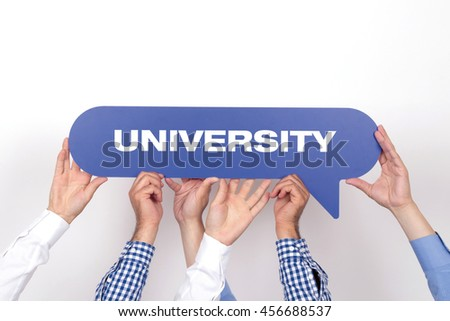 Group of people holding the UNIVERSITY written speech bubble - stock photo