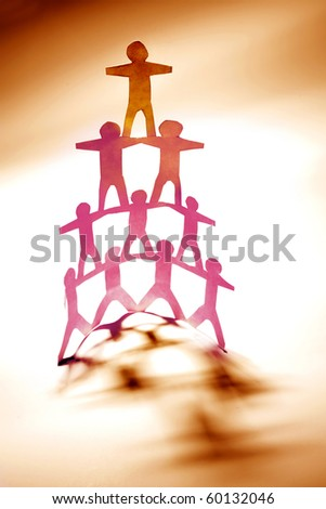Group of people human pyramid - stock photo