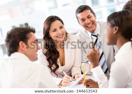 Group of people in a business meeting looking very happy - stock photo