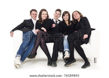 Group of people in a sofa isolated on white background - stock photo