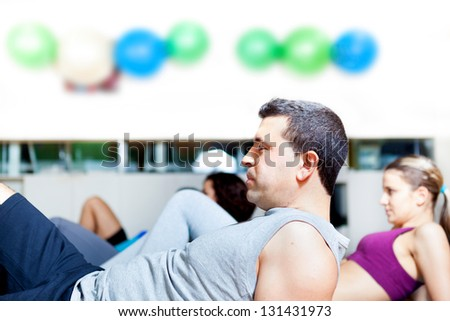 Group of people in aerobics class at the gym - stock photo
