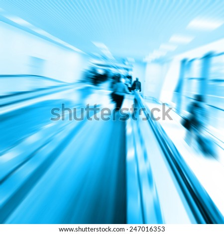 Group of people in motion blur walking in metro station. - stock photo