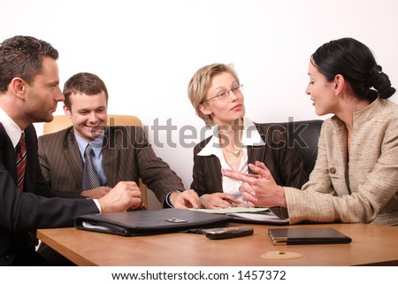 Group of people negotiate at the desk - stock photo