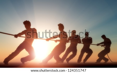 Group of people pulling the rope in the sunlight. - stock photo