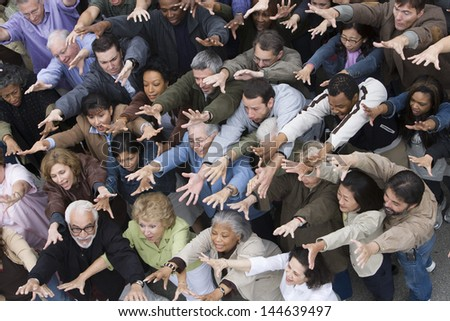 Group of people raising hands all together - stock photo