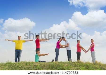 Group of people spelling word TEAM outdoors in nature - stock photo