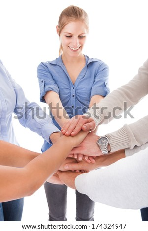 Group Of People Stacking Hand Together Over White Background - stock photo