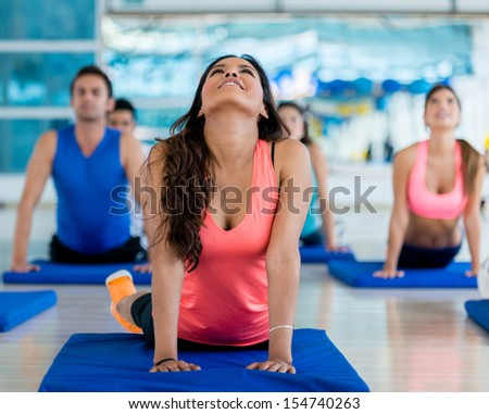 Group of people stretching at the gym  - stock photo