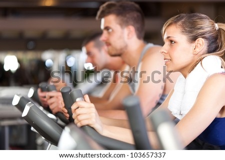 Group of people training in a gym - stock photo