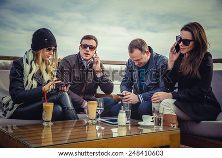Group of people using cell phone - stock photo