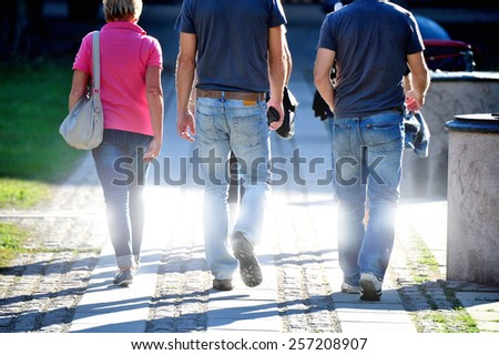 Group of people walking - stock photo