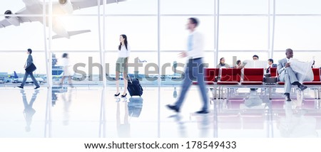 Group of People Walking in the Airport - stock photo