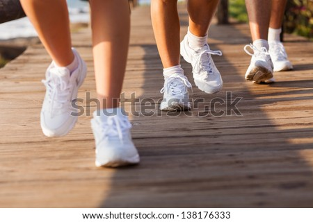 group of people walking on beach for exercising in the morning - stock photo