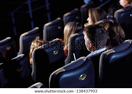 Group of people watching movie at the cinema - stock photo