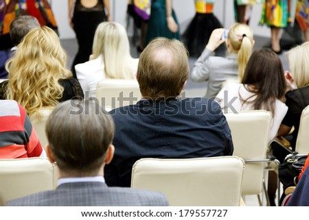group of people watching new fashion models - stock photo