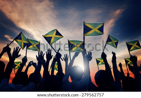 Group of People Waving Flag of Jamaica in Back Lit Concept - stock photo