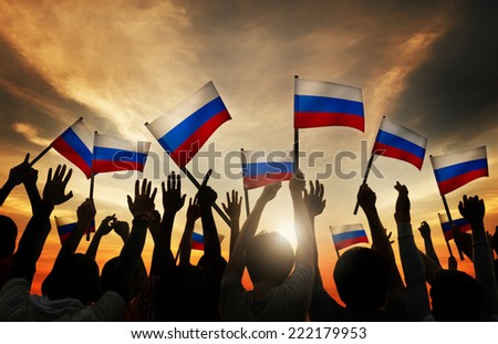 Group of People Waving Russian Flags in Back Lit - stock photo
