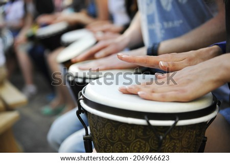 group of people with African drums - stock photo