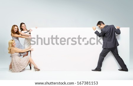 Group of people with big empty advert - stock photo