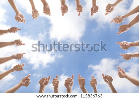 group of people with thumbs up on cloud background - stock photo