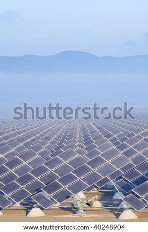 group of photovoltaic panels at sunrise - stock photo